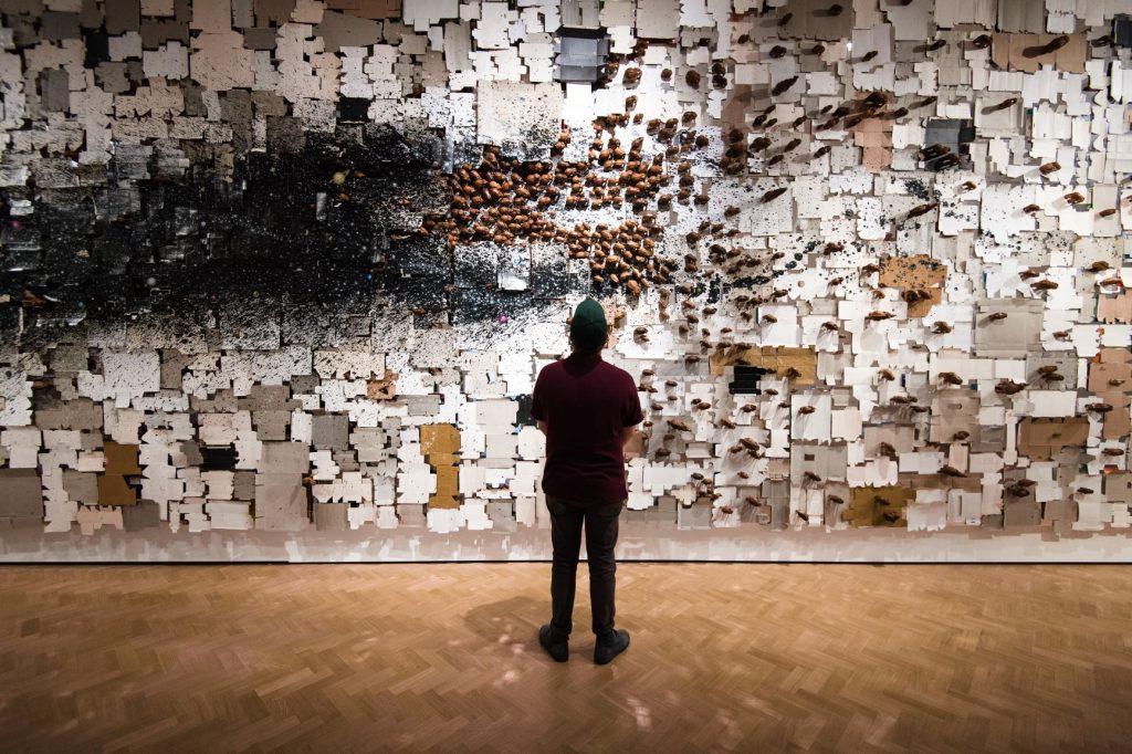 Man staring at art installation