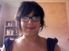A photograph of Dr Lizzie Robles, looking into a webcam