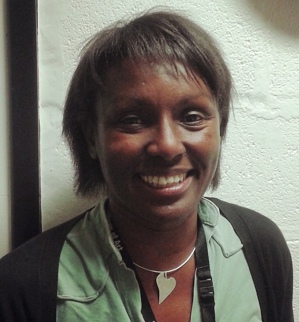 A photograph of Lorna Rose. She is smiling and looking directly into camera.