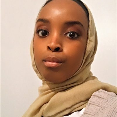 A photograph of Umulkhayr Mohamed. She is looking directly into camera.