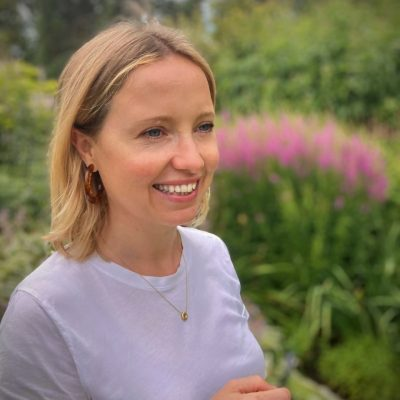 Photo of Heather Sturdy standing in front of some plants